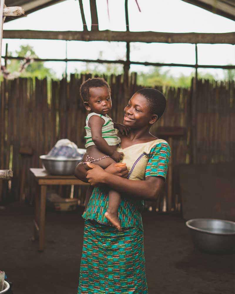 African woman holding a baby